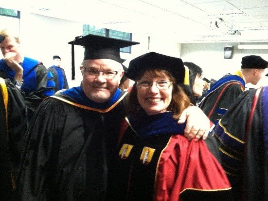 Dr. Hixon and Principal Meyer at her graduation ceremony.